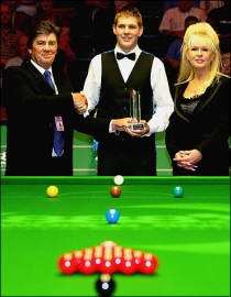 Daniel Wells is presented with the Paul Hunter Scholarship Trophy by Hunter's parents Alan and Christine during the 2007 World Championship at the Crucible on May 3rd.